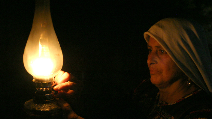 A Palestinian Bedouin women from the Ghwain tribe lights a candle in her home south of Hebron in this May 29, 2008 illustrative photo. (Najeh Hashlamoun /Flash90)