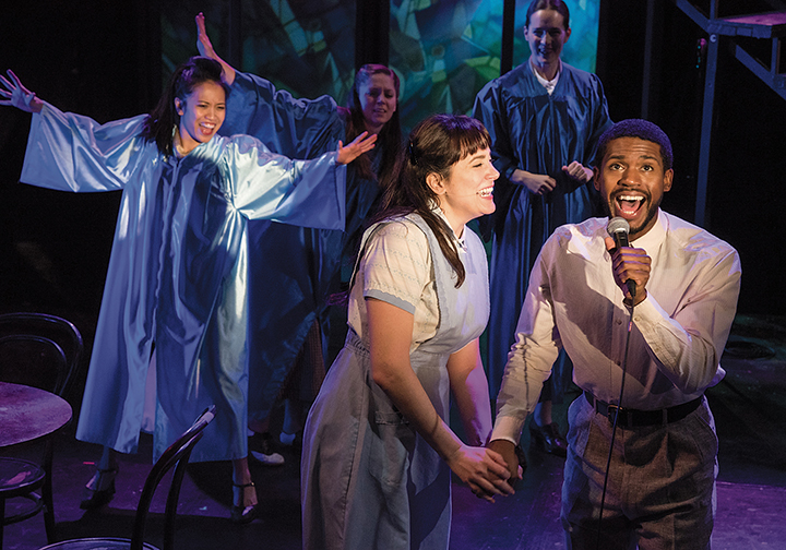 """In """"Rock and Roll Refugee,"""" Dee Roscioli, as Goldie, sings with DeAngelo Kearns. Photo by Russ Rowland"""