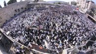 Thousands gather at the Western Wall on Sept. 30, 2015 to receive the Priestly Blessing on the Sukkot holiday. JTA