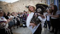 Women of the Wall, who retrieved a Torah scroll from the men's prayer section despite regulations against women. RNS