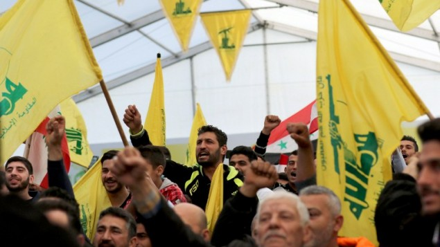 Supporters of Hezbollah chant slogans during a televised speech by leader Hassan Nasrallah in the southern town of Insar, Lebanon, on March 6, 2016. (AFP/Mahmoud Zayyat)