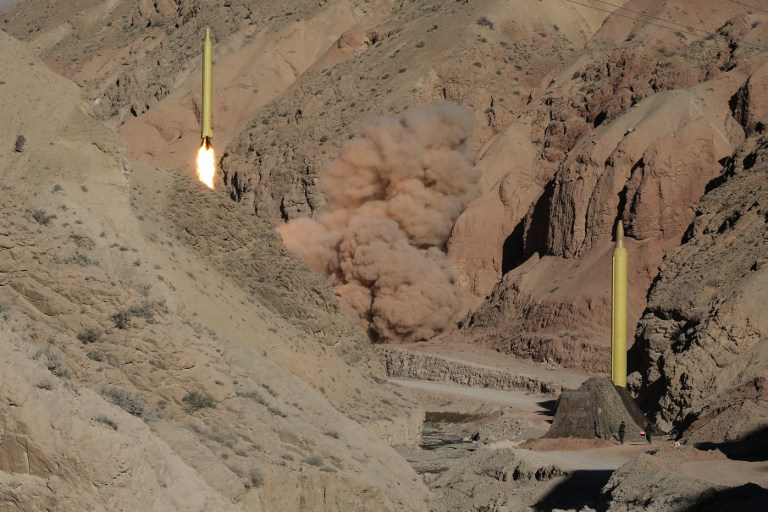 A long-range Qadr ballistic missile is launched in the Alborz mountain range in northern Iran on March 9, 2016. (AFP / TASNIM NEWS / Mahmood Hosseini)
