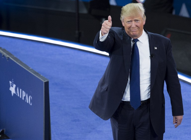 US Republican presidential hopeful Donald Trump gives a thumbs-up as he arrives to speak during the American Israel Public Affairs Committee (AIPAC) 2016 Policy Conference at the Verizon Center in Washington, DC, March 21, 2016. (AFP / SAUL LOEB)