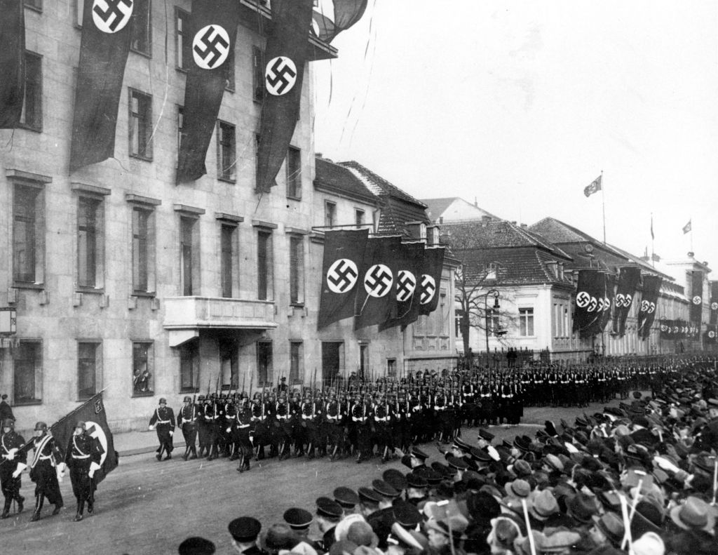 An Associated Press photograph shows a parade of Nazi black guards marching past the Reich Chancellory on Wilhelmstrasse during their parade in Berlin, Germany, on Jan. 30, 1937. (AP)