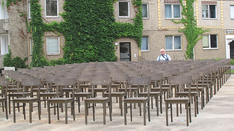 Tuvia Tanenbom sits alone at a memorial for Jews murdered in World War II.