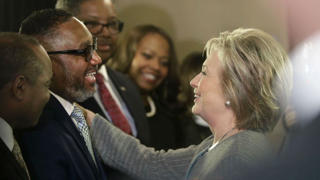 Democratic presidential candidate Hillary Clinton meets with the Rev. Kenneth J. Flowers of the Greater New Mt. Moriah Missionary Baptist Church before meeting with African American ministers, Saturday, March 5, 2016, in Detroit, Michigan. (AP Photo/Carlos Osorio)