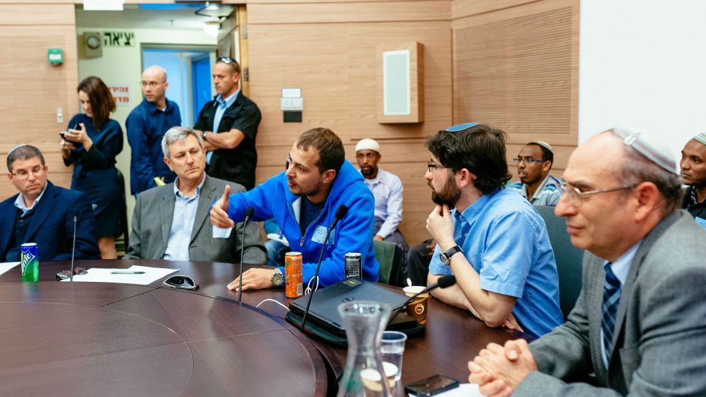 FSU immigrant David (in blue sweatshirt) gives testimony at the Knesset's Aliya Committee on March 8, 2016. Also pictured, from left: Giyur KaHalacha's Rabbi Seth Farber, Eli Cohen, director, and lawyer Elad Caplan. (Michael Shapochnic, Giyur KaHalacha)