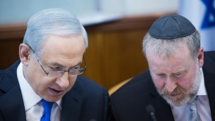 Prime Minister Benjamin Netanyahu (L) confers with Avichai Mandelblit, then still cabinet secretary, during a weekly cabinet meeting in Jerusalem, on December 20, 2015 (Yonatan Sindel/Flash90)