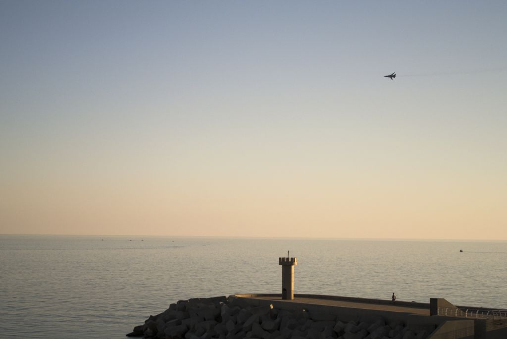 In this photo taken on Tuesday, March 1, 2016, a Russian Su-24 bomber flies over the Mediterranean sea in Latakia, Syria. Associated Press spent five days traveling through the port of Latakia and the surrounding areas in Syria during the cease-fire. (AP Photo/Vladimir Isachenkov)