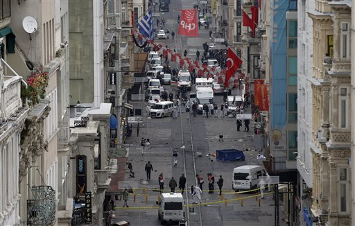 Emergency services at the scene of a suicide bombing on a busy shopping street in Istanbul, Turkey on March 19, 2016. (AP Photo/Emrah Gurel)