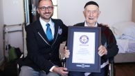 Marco Frigatti, head of records for Guinness World Records, presents Israel Kristal his certificate of achievement. JTA