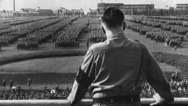 German Fuhrer and Nazi leader Adolf Hitler addressing soldiers with his back facing the camera at a Nazi rally in Germany. JTA