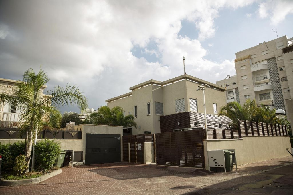 In this Tuesday, Nov. 10, 2015, photo, the house belonging to convicted con man Gilbert Chikli is seen in the port city of Ashdod, Israel. Chikli remains a wanted man, but lives openly in Israel. Israel and France share no bilateral extradition treaty, but Israel has surrendered French citizens in the past. (AP Photo/Tsafrir Abayov)