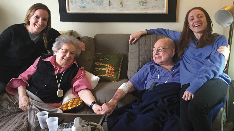 Inge and Kurt Silbermann, who were married for 68 years, hold hands; their granddaughters Sarah, left, and Elizabeth share the love.