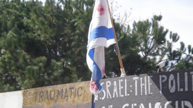 "At UCLA, during the last week of February 2010, a blood-stained Israeli flag was hoisted atop an ""apartheid wall."" JTA"