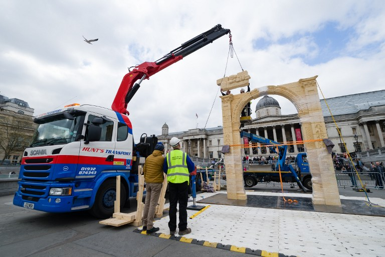 A replica of Palmyra's Arch of Triumph is erected in Trafalgar Square, central London, on 18 April 2016, the day before it is officially unveiled. (AFP PHOTO / LEON NEAL)