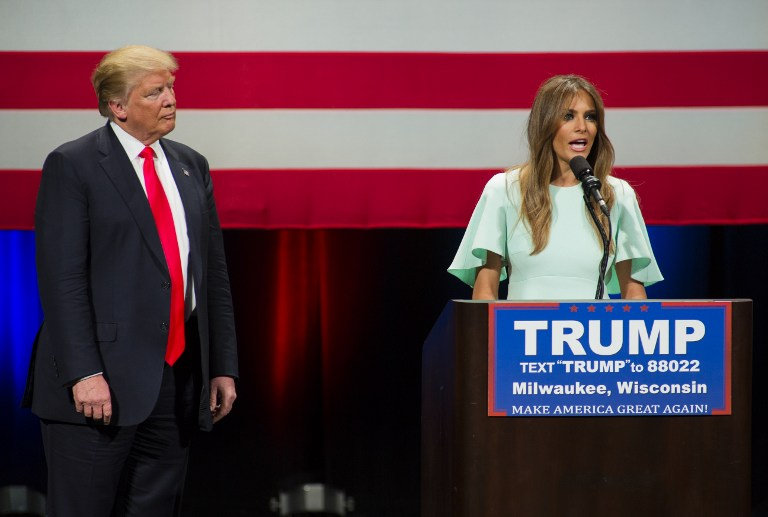 presidential candidate Donald Trump listens to his wife Melania Trump ...