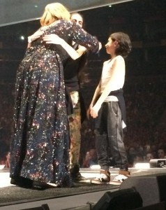 Adele hugs Isabella Kindler, 12 and her brother Austin, 9