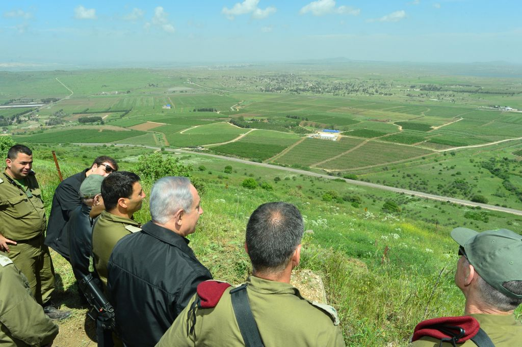 Benjamin Netanyahu is seen during a security tour in the Golan Heights, near Israel's northern border with Syria, on April 11, 2016. (Kobi Gideon/GPO)