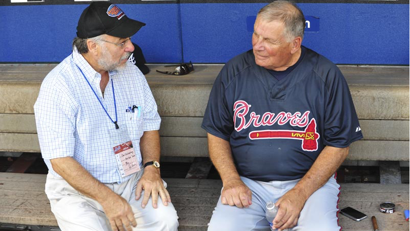 Bobby Cox, right, talking to Dan Schlossberg, was Atlanta's manager during its winning streak.