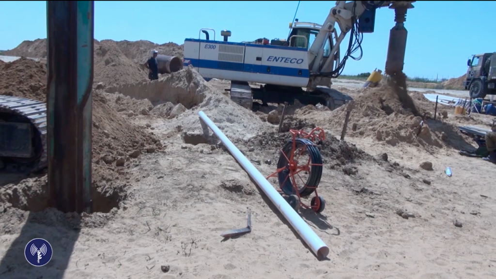 Israeli soldiers and civilians use heavy engineering equipment to discover a Hamas attack tunnel near the Gaza border last week, in a video released on April 18, 2016. (Screen capture: IDF Spokesperson's Unit)