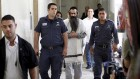 Yishai Schlissel being led away by police in handcuffs, following the murder of the 16-year old Shira Banki