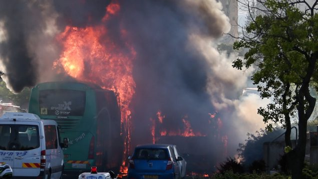 Firefighters and rescue personnel at the scene of a bus bombing in the Talpiot neighborhood of Jerusalem, April 18, 2016. JTA