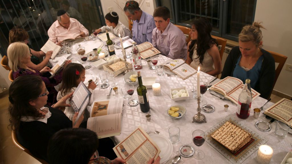 An Israeli family seen during the Passover seder on the first night of the eight-day long Jewish holiday. (Nati Shohat/Flash 90)