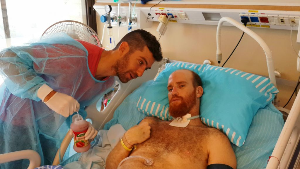 Sadan with friends in the hospital during his recovery. (Courtesy Roei Sadan)