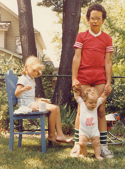 Lizzie, David, and their baby sister, Miriam, in their Englewood backyard.