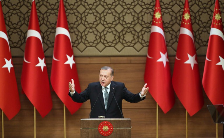 Turkish President Tayyip Erdogan gestures during a speech with local village and town leaders at the Presidential Palace in Ankara, on May 4, 2016. (AFP/Adem Altan)