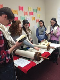 Students read Torah at Koach at Rutgers Hillel.