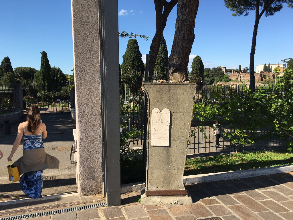 At the entrance to the garden is a memorial plaque in the shape of the Stone Tablets on which the Ten Commandments were etched. Jewish visitors to the site often leave small stones atop the plaque, just as they do by a tombstone to honor the dead (Rossella Tercatin/Times of Israel)