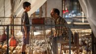 "Talking turkey farming: Asher Avrahami, left, and Navid Negahban in a scene from ""Baba Joon."" United King Features"