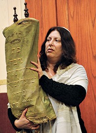 Rabbi Debra Orenstein is pictured with the Torah. (Courtesy CBI)