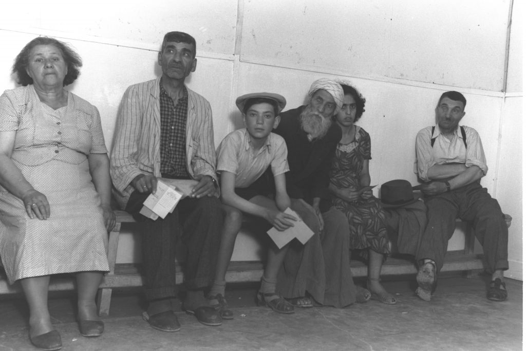 Immigrants from Iraq, Poland and Romania wait for medical examinations at the Atlit transit camp in northern Israel in summer 1951 (Teddy Brauner, GPO)