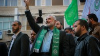 Senior Hamas leader Ismail Haniyeh gestures to the crowd as he takes part in a rally marking the 28th anniversary of Hamas' founding, in Gaza City on December 14, 2015. (Photo Credit: Emad Nassar / FLASH90)