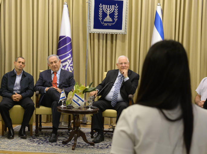 President Reuven Rivlin and Prime Minister Benjamin Netanyahu attend an award ceremony for Shin Bet officers awarded for outstanding performance on May 24, 2016. (Amos Ben Gershom/GPO)