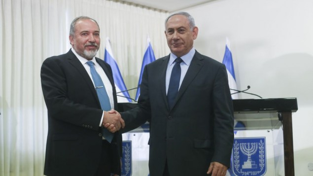 Prime Minister Benjamin Netanyahu and Yisrael Beytenu party leader Avigdor Liberman shake hands after signing a coalition agreement in the Knesset on Wednesday, May 25, 2016 (Yonatan Sindel/FLASH90)