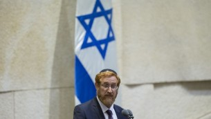 Yehuda Glick speaks to the Knesset plenum during his swearing in ceremony as a member of Knesset on Wednesday, May 25, 2016 (Yonatan Sindel/Flash90)