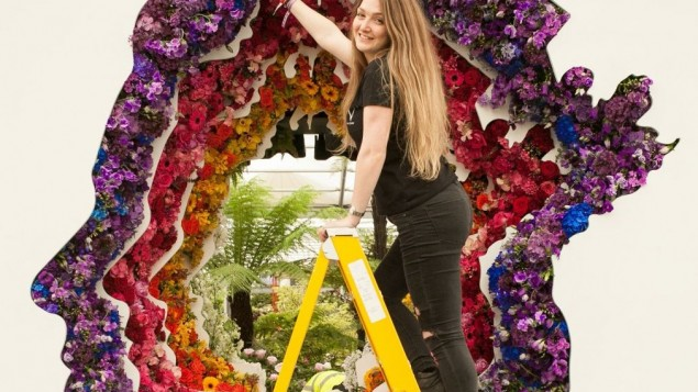 Gaby Lebetkin places the final flower in the crown for New Covent Garden Flower Market's debut stand, 'Behind Every Great Florist', designed by Veevers Carter