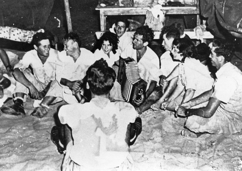 A Palmach-era kumzitz, where accordion and singing, sometimes accompanied by a bonfire with hot potatoes tucked underneath, went hand in hand (Courtesy Palmach archives)