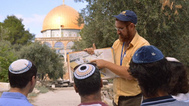 On a tour of the Temple Mount, Yehuda Glick shows religious Jews a diagram of the Jewish Temple, which once stood where the golden Dome of the Rock stands today, September 17, 2013, in Jerusalem Israel. (Christa Case Bryant/The Christian Science Monitor via Getty Images)