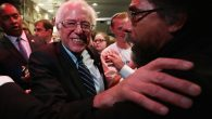 Democratic presidential candidate Bernie Sanders, left, embracing philosopher and social activist Cornel West in Iowa. JTA