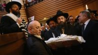 An infant being carried before his circumcision at an Orthodox synagogue in Berlin in 2013. JTA