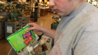The author's son George helping unpack groceries. Courtesy of Gabrielle Kaplan-Mayer
