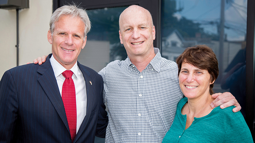 Israel's former ambassador to the United States, Michael Oren, stands with Jeff Aeder and his wife, Jennifer Levine, outside the Wolcott School. Mr. Oren talked to the students about his struggle with dyslexia.