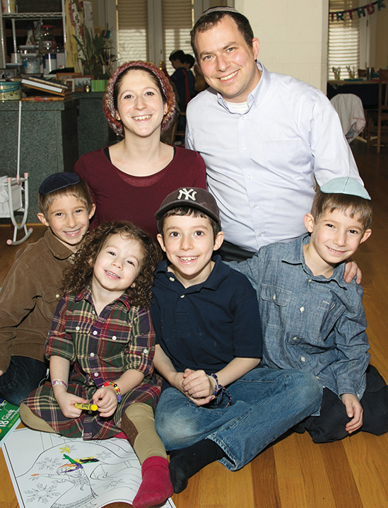 Sara Tillinger Wolkenfeld and Rabbi David Wolkenfeld with their children.