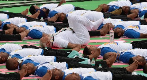 Indian Prime Minister Narendra Modi (center in white) participates in a mass yoga session along with other Indian yoga practitioners to mark the 2nd International Yoga Day at Captol complex in Chandigarh on June 21, 2016. (Prakash Singh/AFP)