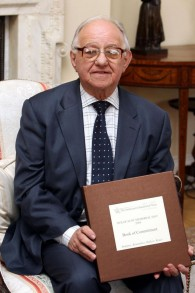 Holocaust survivor Zigi Shipper holding the Book of Commitment to mark Holocaust Memorial Day in Downing Street